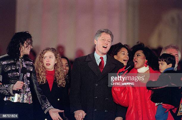 US Presidentelect Bill Clinton and his daughter chelsea join singers Michael Jackson and Diana Ross in the song 'We are the world' on January 17 1993...