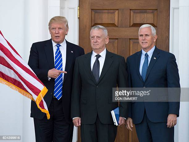 US Presidentelect Doanld Trump poses for a photo with US Marines General James Mattis James Mattis and Vice Presidentelect Mike Pence on the steps of...
