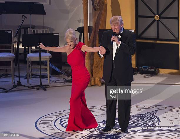 Presidentelect Donald J Trump and campaign manager Kellyanne Conway take a bow at the Indiana Society Ball to thank donors January 19 2017 in...