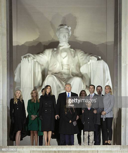 Presidentelect Donald J Trump and family stand in front of the Lincoln Memorial at the inaugural concert in January 19 2017 in Washington DC Hundreds...