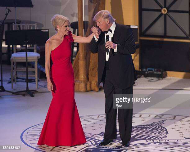 Presidentelect Donald J Trump kisses the hand of campaign manager Kellyanne Conway at the Indiana Society Ball to thank donors January 19 2017 in...