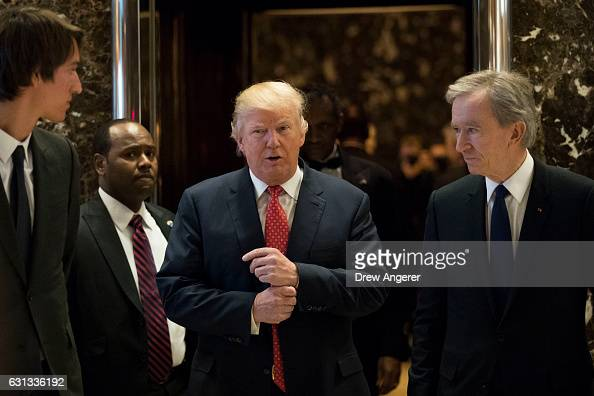 Presidentelect Donald Trump and French businessman Bernard Arnault chief executive officer of LVMH emerge from the elevators to speak to reporters at...