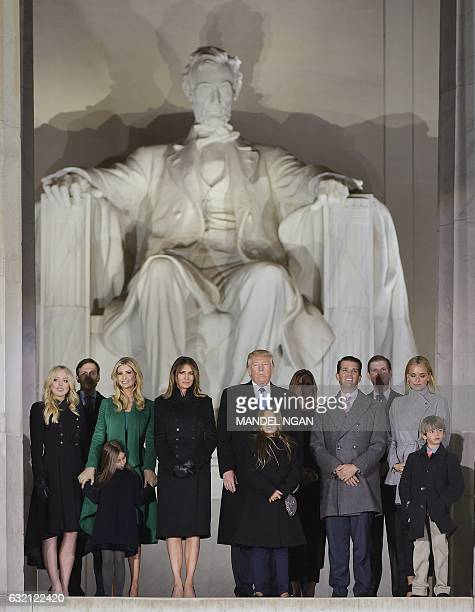 Presidentelect Donald Trump and family pose at the end of a welcome celebration at the Lincoln Memorial in Washington DC on January 19 2017 / AFP /...
