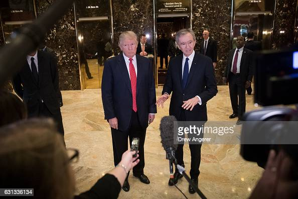 Presidentelect Donald Trump and French businessman Bernard Arnault chief executive officer of LVMH speak to reporters at Trump Tower January 9 2017...