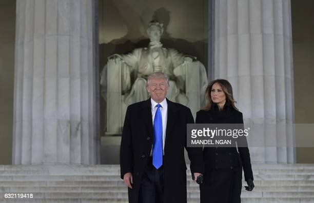 Presidentelect Donald Trump and his wife Melania arrive to attend an inauguration concert at the Lincoln Memorial in Washington DC on January 19 2017...