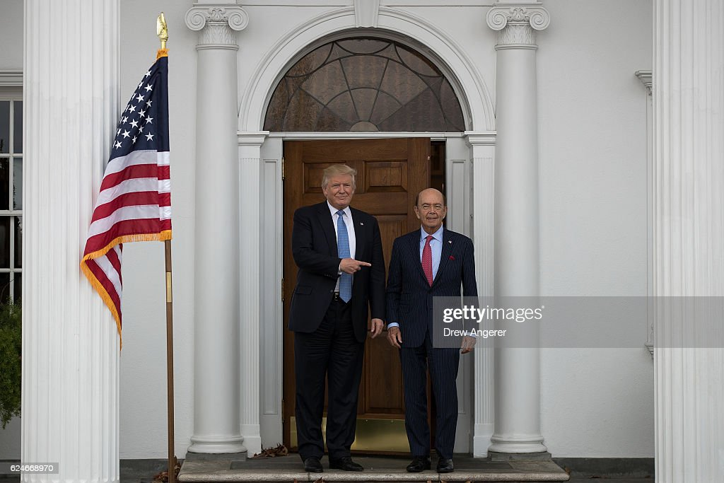 President-elect Donald Trump and investor Wilbur Ross pose for a photo following their meeting at Trump International Golf Club, November 20, 2016 in Bedminster Township, New Jersey. Trump and his transition team are in the process of filling cabinet and other high level positions for the new administration.