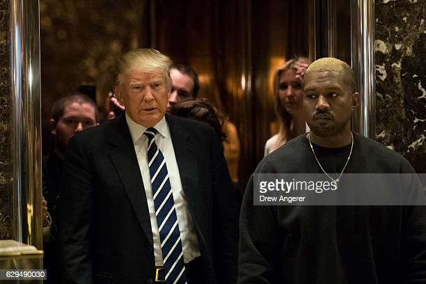 Presidentelect Donald Trump and Kanye West exit an elevator and walk into the lobby at Trump Tower December 13 2016 in New York City Presidentelect...