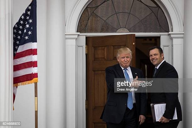 Presidentelect Donald Trump and Kris Kobach Kansas secretary of state pose for a photo following their meeting with presidentelect at Trump...