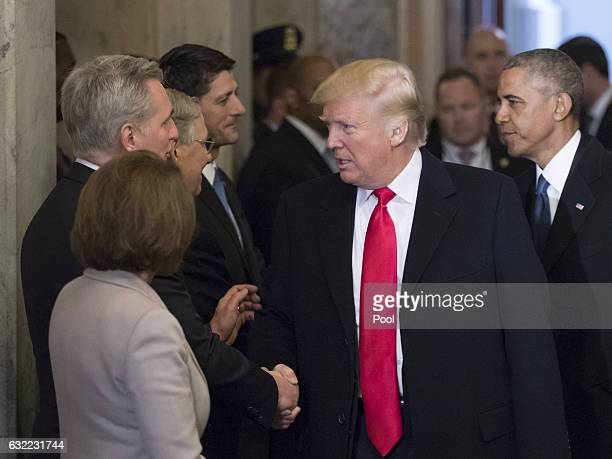 Presidentelect Donald Trump and President Barack Obama are greeted by members of the Congressional leadership including Minority Leader Nancy Pelosi...