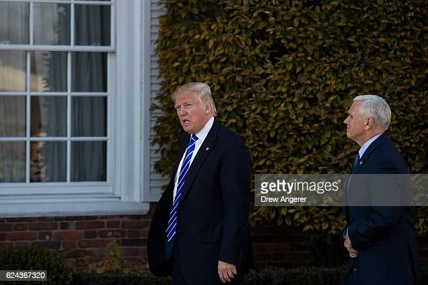 Presidentelect Donald Trump and Vice presidentelect Mike Pence arrive at the clubhouse at Trump International Golf Club November 19 2016 in...