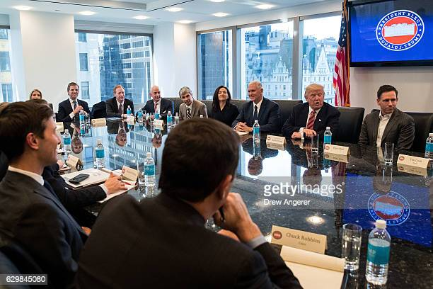 Presidentelect Donald Trump and Vice Presidentelect Mike Pence meet with technology executives at Trump Tower December 14 2016 in New York City This...