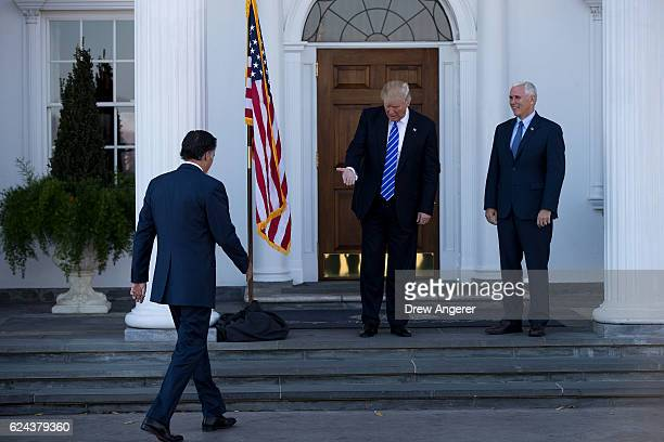 Presidentelect Donald Trump and vice presidentelect Mike Pence welcome Mitt Romney to the clubhouse at Trump International Golf Club November 19 2016...