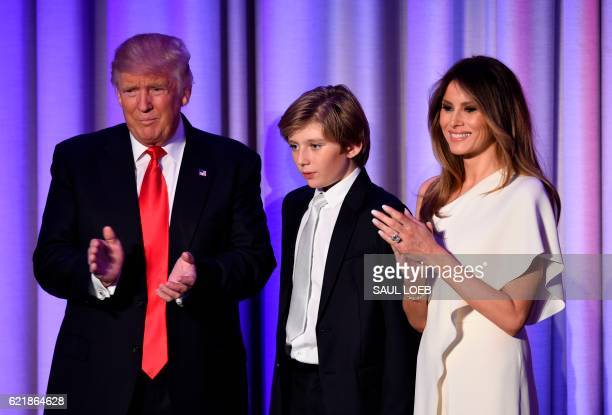 Presidentelect Donald Trump arrives with his son Baron and wife Melania at the New York Hilton Midtown in New York on November 8 2016 Trump stunned...