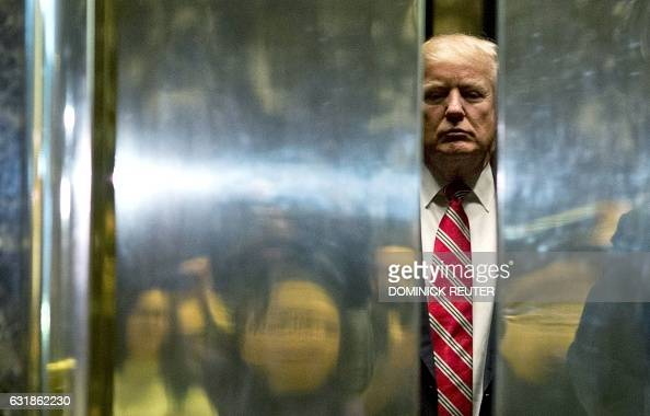 Presidentelect Donald Trump boards the elevator after escorting Martin Luther King III to the lobby after meetings at Trump Tower in New York City on...