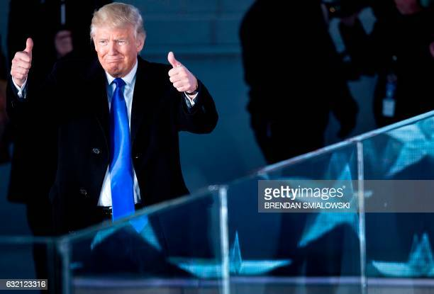Presidentelect Donald Trump gestures during a welcome celebration at the Lincoln Memorial in Washington DC on January 19 2017 / AFP / Brendan...