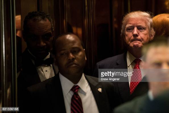 Presidentelect Donald Trump gets into the elevator after speaking to reporters in the lobby after meeting with French businessman Bernard Arnault...