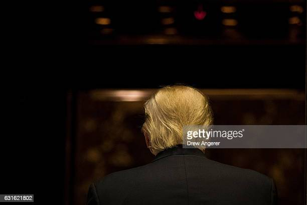 Presidentelect Donald Trump gets into the elevator after speaking to reporters after his meeting with television personality Steve Harvey at Trump...