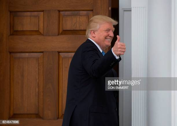 Presidentelect Donald Trump gives a thumbs up the the media at the clubhouse of Trump National Golf Club November 20 2016 in Bedminster New Jersey /...