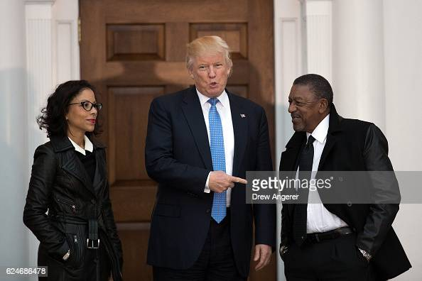 Presidentelect Donald Trump greets Robert Johnson the founder of Black Entertainment Television and his wife Lauren Wooden as they arrive for a...