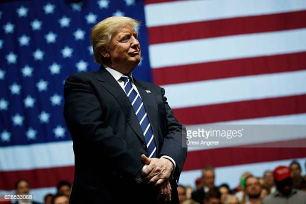 Presidentelect Donald Trump looks on during a rally at the DeltaPlex Arena December 9 2016 in Grand Rapids Michigan Presidentelect Donald Trump is...