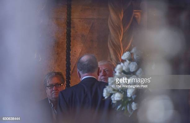 Presidentelect Donald Trump meets with Ronald Lauder center and Trump's strategist Stephen K Bannon left at MaraLago Club on December 28 2016 in Palm...