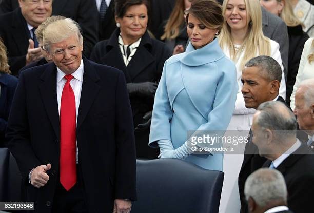 US Presidentelect Donald Trump Melania Trump and President Barack Obama arrive on the West Front of the US Capitol on January 20 2017 in Washington...
