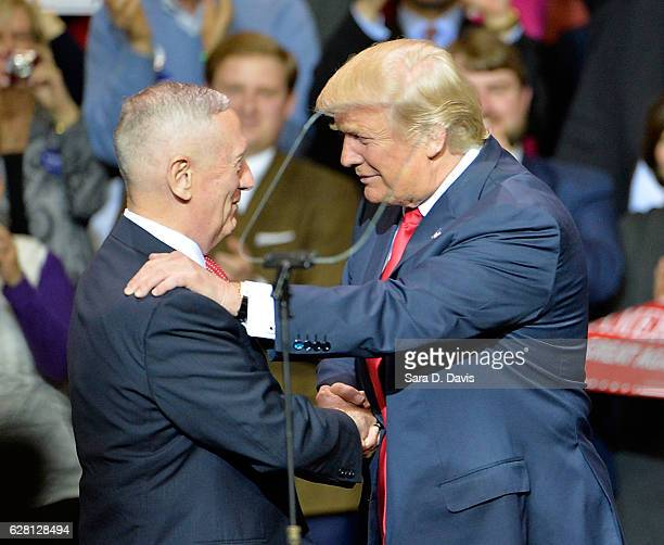 Presidentelect Donald Trump shakes the hand of retired US Marine General James Mattis after naming him Secretary of Defense at Crown Coliseum on...