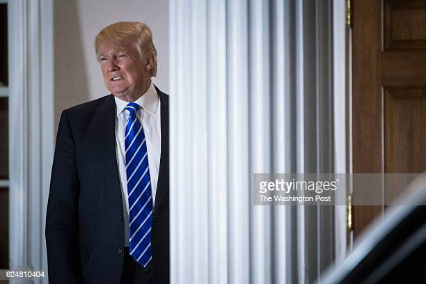 Presidentelect Donald Trump shouts out to members of the media at the clubhouse at Trump National Golf Club Bedminster in Bedminster Township NJ on...