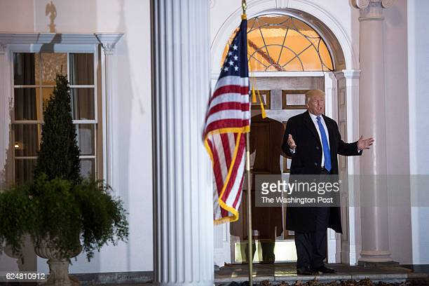 Presidentelect Donald Trump shouts to members of the media at the clubhouse at Trump National Golf Club Bedminster in Bedminster Township NJ on...