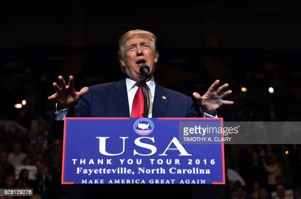 Presidentelect Donald Trump speaks at the Crown Coliseum in Fayetteville North Carolina on December 6 2016 during his USA Thank You Tour / AFP /...