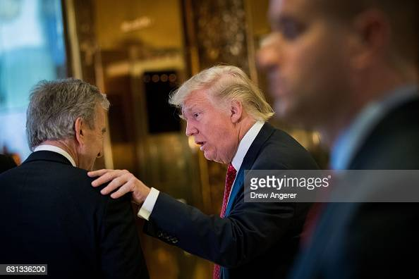Presidentelect Donald Trump speaks to French businessman Bernard Arnault chief executive officer of LVMH after speaking to reporters at Trump Tower...