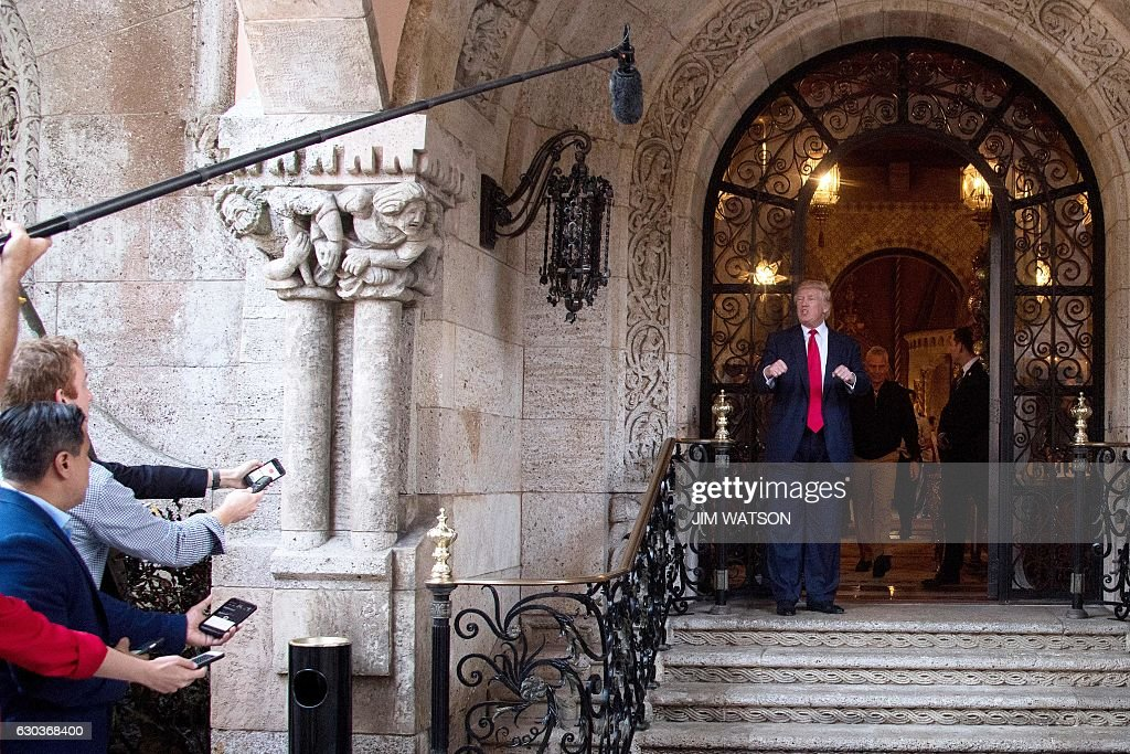 US President-elect Donald Trump speaks to reporters at Mar-a-Lago in Palm Beach, Florida where he is taking meetings on December 21, 2016. / AFP / JIM