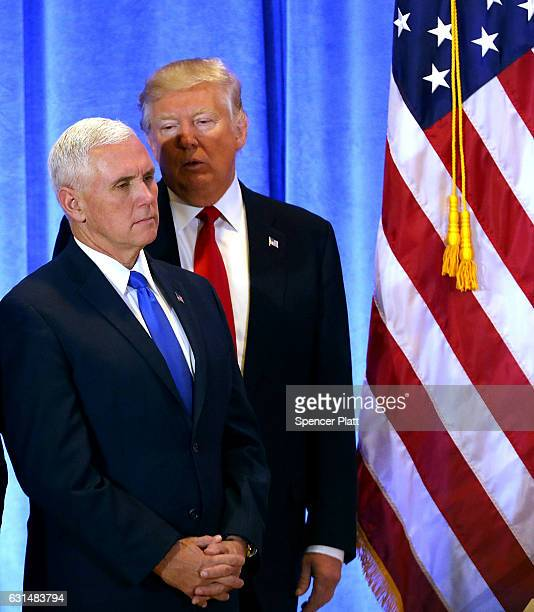 Presidentelect Donald Trump stands with Vice Presidentelect Mike Pence at a news conference at Trump Tower on January 11 2017 in New York City This...
