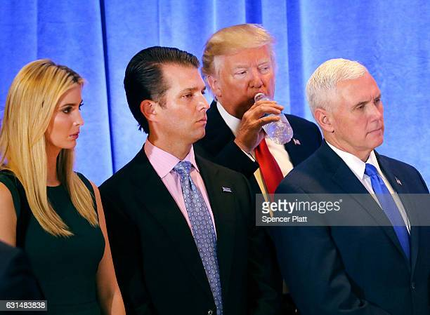 Presidentelect Donald Trump stands with Vice Presidentelect Mike Pence Trump's son Donald Trump Jr and his daughter Ivanka at a news conference at...