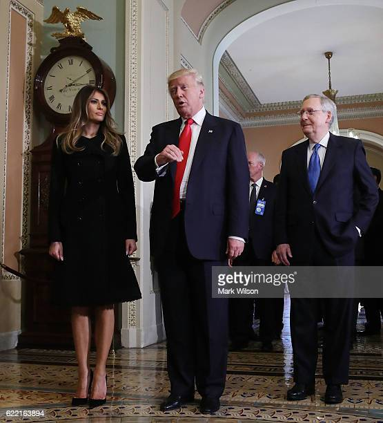 Presidentelect Donald Trump talks to the media while joined by his wife Melania Trump and Senate Majority Leader Mitch McConnell after a meeting at...