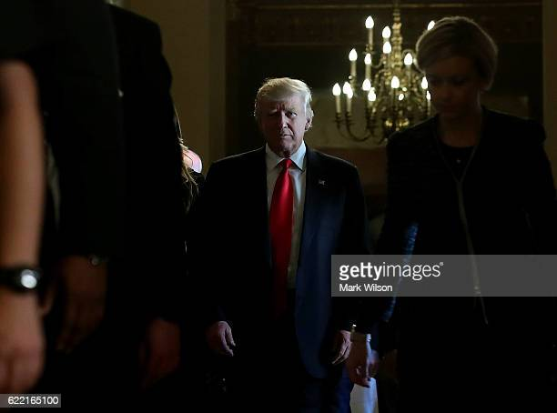 Presidentelect Donald Trump walks from a meeting with Senate Majority Leader Mitch McConnell at the US Capitol November 10 2016 in Washington DC...