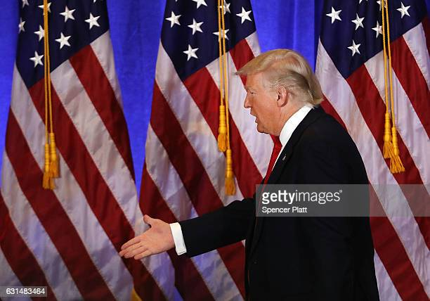 Presidentelect Donald Trump walks off of stage following a news cenference at Trump Tower on January 11 2017 in New York City This was Trump's first...