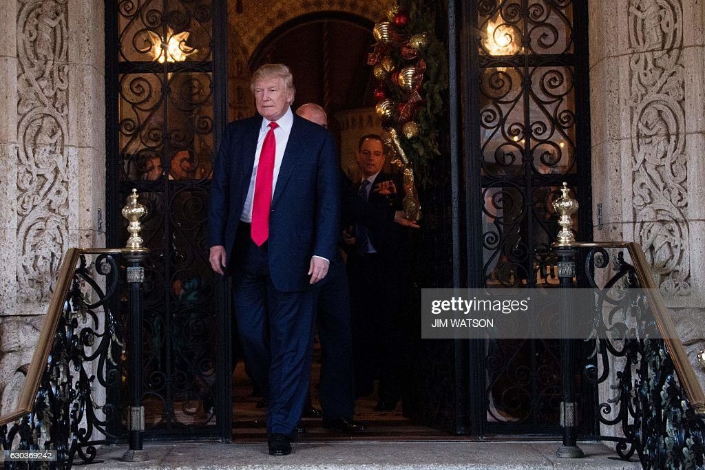 US President-elect Donald Trump walks out to speak to the media at Mar-a-Lago in Palm Beach, Florida after meetings with US military leadership on December 21, 2016. / AFP / JIM