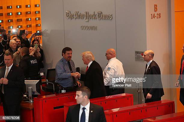 Presidentelect Donald Trump walks through the lobby of the New York Times following a meeting with editors at the paper on November 22 2016 in New...