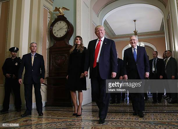 Presidentelect Donald Trump walks with his wife Melania Trump and Senate Majority Leader Mitch McConnell after a meeting at the US Capitol November...