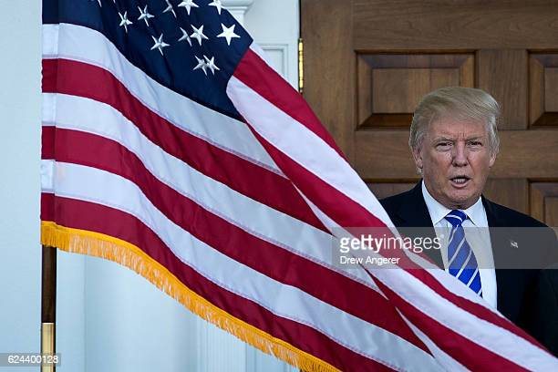 Presidentelect Donald Trump welcomes retired United States Marine Corps general James Mattis before their meeting at Trump International Golf Club...