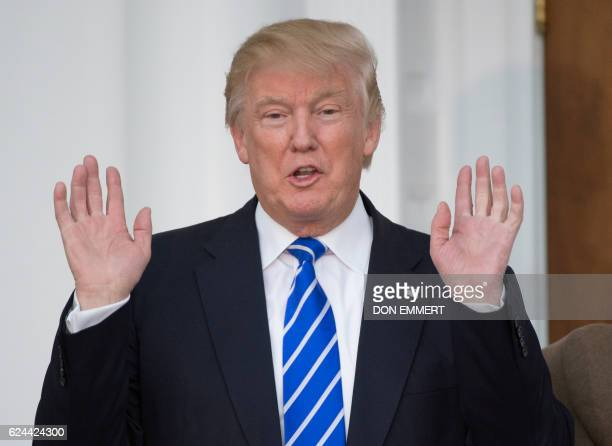 US Presidentelect Donald Trump yells out to the media from the steps of the clubhouse of Trump National Golf Club November 19 2016 in Bedminster New...