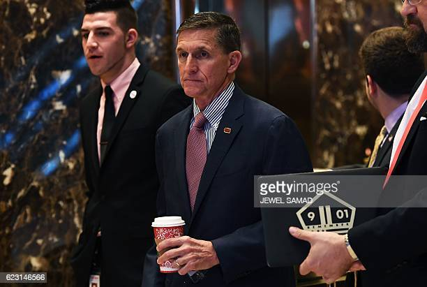 US Presidentelect Donald Trump's adviser Lt Gen Michael Flynn arrives at the Trump Tower in New York on November 14 2016 Presidentelect Donald Trump...