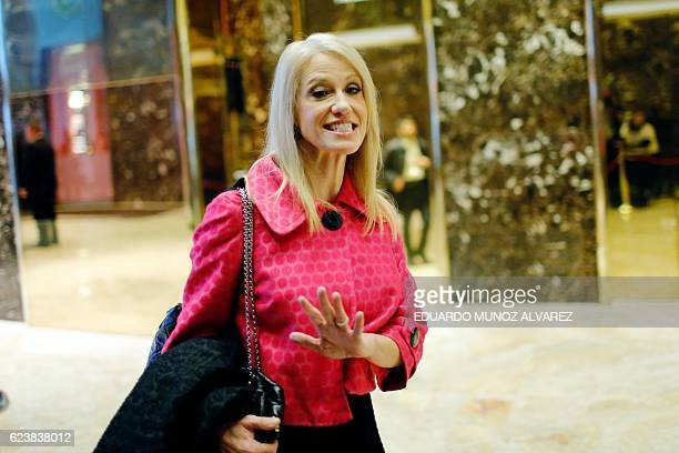 US PresidentElect Donald Trump's campaign manager Kellyanne Conway talks to the press as she arrives at the Trump Tower for meetings with US...