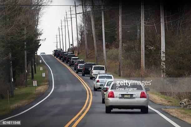 Presidentelect Donald Trump's motorcade drives on its way to Lamington Presbyterian Church November 20 2016 in Bedminster Township New Jersey Trump...