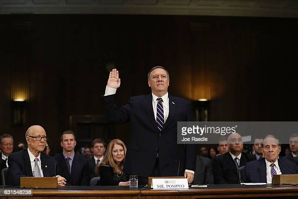 S Presidentelect Donald Trump's nominee for the director of the CIA Rep Mike Pompeo is sworn in at his confirmation hearing before the Senate...