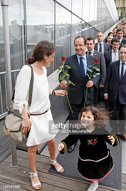 Presidentelect Francois Hollande gives a red rose to Mazarine Pingeot the daughter of late President Francois Mitterrand as they arrive for a visit...