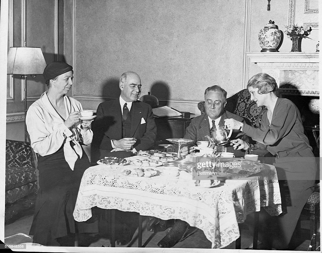 President-elect <a gi-track='captionPersonalityLinkClicked' href=/galleries/search?phrase=Franklin+Roosevelt&family=editorial&specificpeople=70026 ng-click='$event.stopPropagation()'>Franklin Roosevelt</a> has tea with New York Governor Herbert Lehman. Eleanor is on the left; Edith Lehman pours the tea.