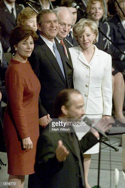 S Presidentelect George W Bush his wife Laura Vice Presidentelect Dick Cheney and his wife Lynne listen to Lee Greenwood sing at a event for American...
