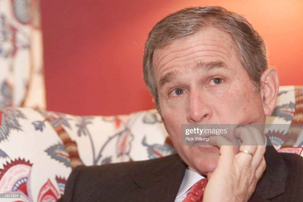 Presidentelect George W Bush listens during an interview January 18 2001 in Washington DC Bush promised an inaugural address devoted to bringing...